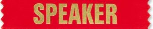 "The word ""speaker"" written in gold with a red background."