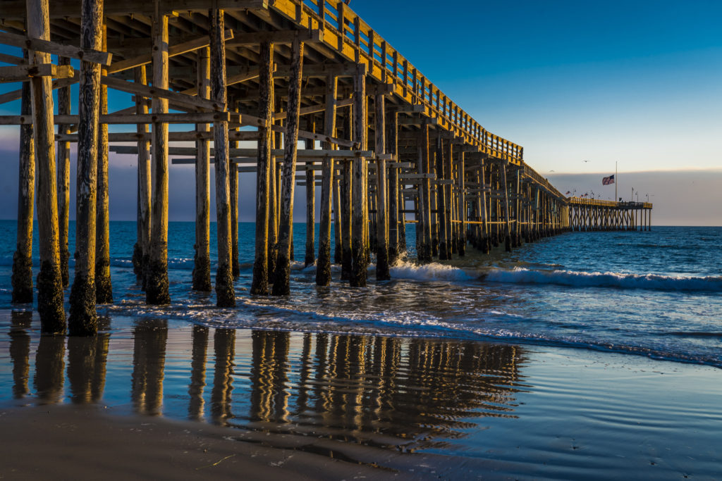 A pier located in Ventura, California with the ocean in the background.
