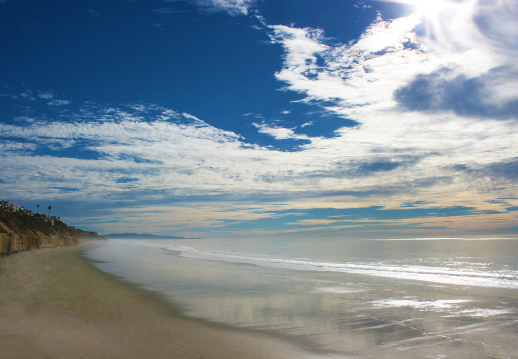 The view of the beach in Solana Beach, California taken from the sand.